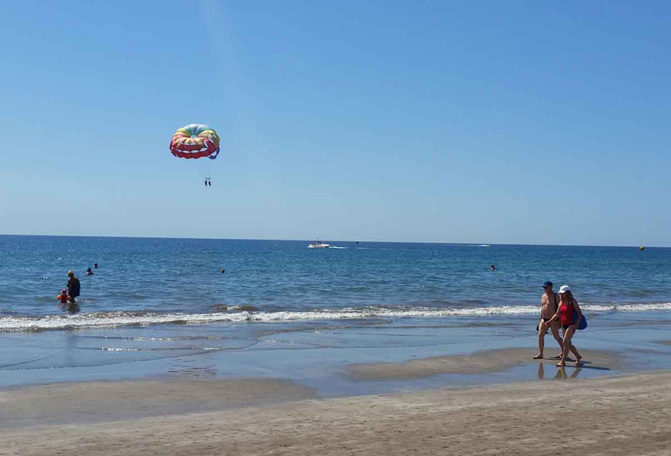 Parasailing near the Atlantic ocean and the beach of Playa del Ingles