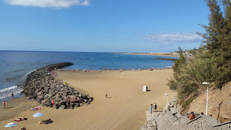 On holiday at the beach of Playa del Ingles in Gran Canaria